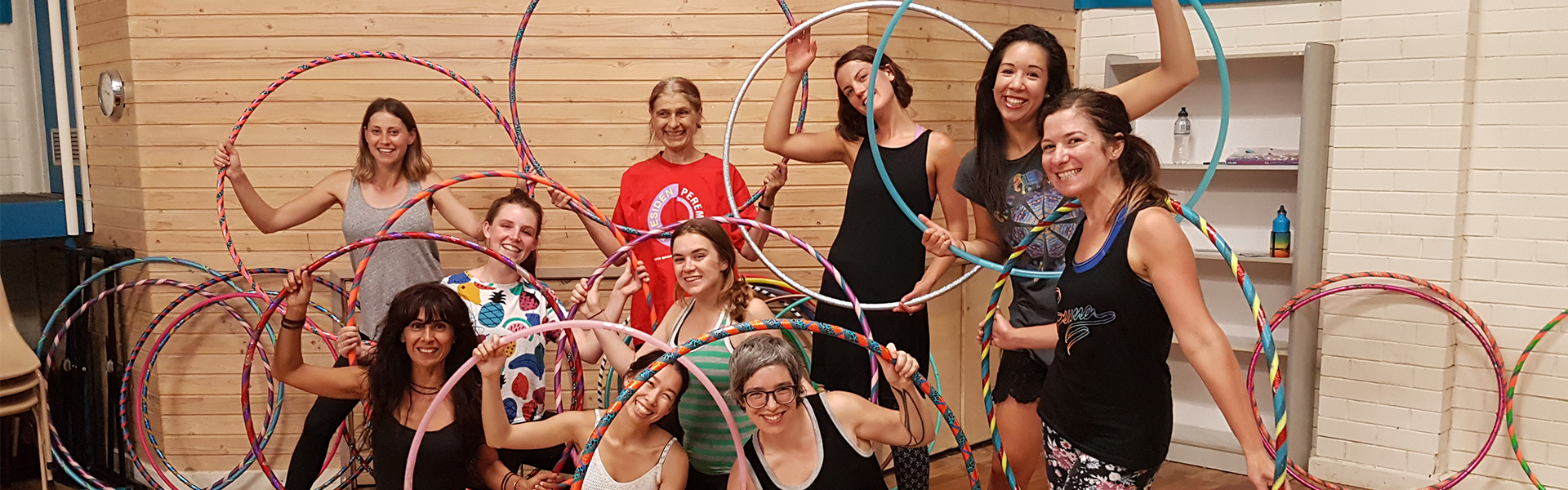 Hula hoop class students posing with hoops after Hoop Sparx hula hoop class melbourne