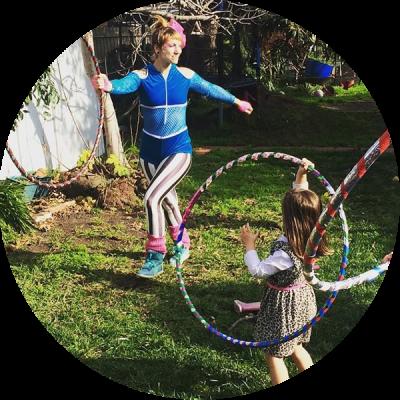 Donna Sparx teaching kids hoop dance at hula hoop birthday party