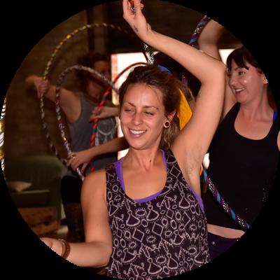 Hula Hoopers dancing with their hoops at Hoop Sparx Hoop Ma Boogie hula hoop workshop event.