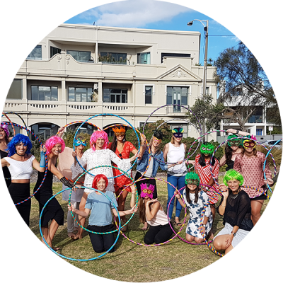 Hula Hoop Hens Party in St Kilda with group of friends with hula hoops dressed up in Eighties wigs and lycra