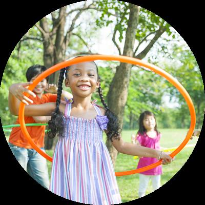 Kids Hula Hooping at a Hoop Sparx Holiday Program