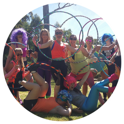 Ladies posing with their hula hoops after a Hoop Sparx Hoopy Hens Party in St Kilda