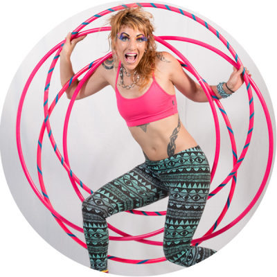 Donna Sparx and her four pink hula hoops in a hoop mandala