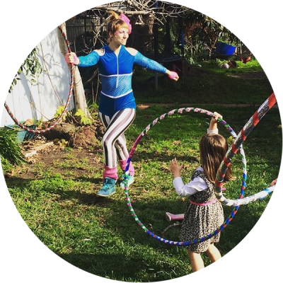 Donna Sparx teaching kids hoop dance at hula hoop birthday party