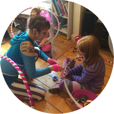 Donna Sparx teaching the birthday girl how to make a hula hoop at her hula hoop birthday party