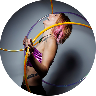 Donna Sparx Hula Hooping with multiple hoops and laughing