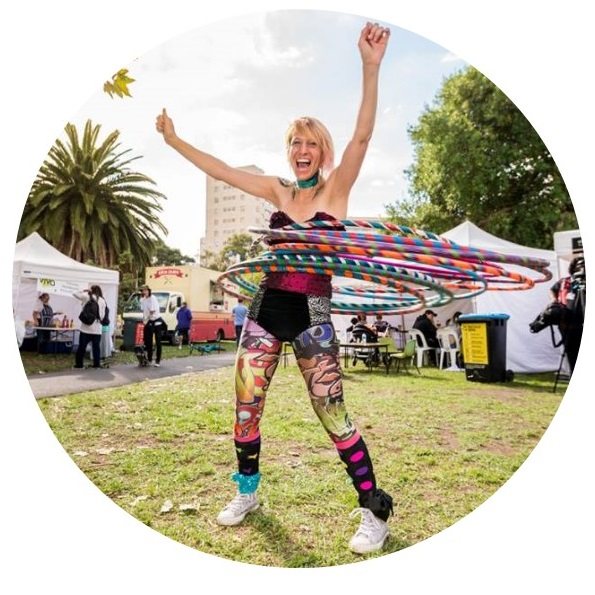 Hula hooper Donna Sparx with mutiple hoops performing at youth festival