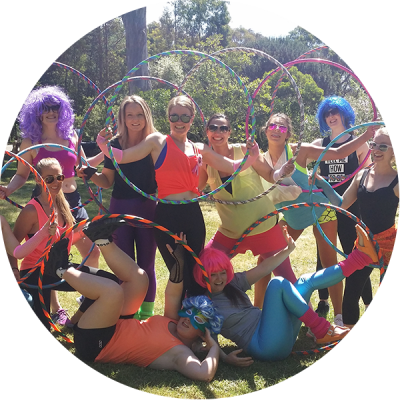 Ladies posing with their hula hoops after a Hoop Sparx Hoopy Hens Party in Melbourne
