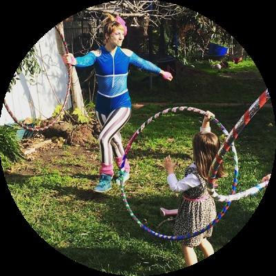 Donna Sparx teaching kids hula hoop dance at a hula hoop children's birthday party