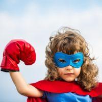 hula hooping makes you strong. Super hero kid